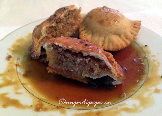 Cauzuncill' (cow-zoon-cheel) with almond and vino cotto filling, drizzled with vino cotto