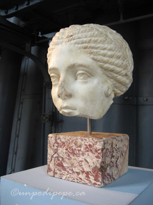 Partial female head, discovered in the garden of Villa Rivaldi in 1933 during construction of Via dei Fori Imperiali