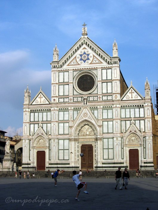 Piazza Santa Croce with statue of Dante on the left.