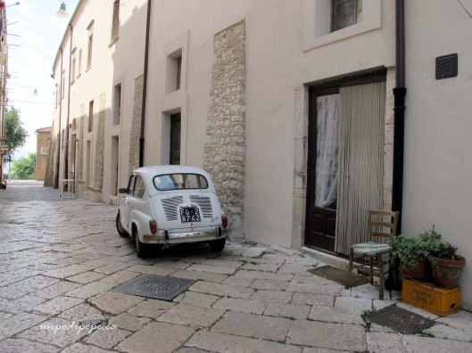 Side street in Troia with Fiat Seicento (600)