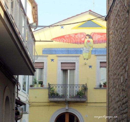 House in Troia, Puglia with Leon Marino angel mural