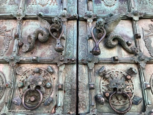 Troia cathedral dragon door handles and lion knockers