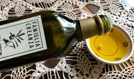 Pouring Famiglia Creanza Extra virgin olive oil