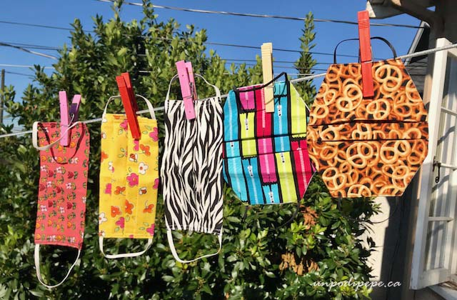 5 masks hanging on a clothesline