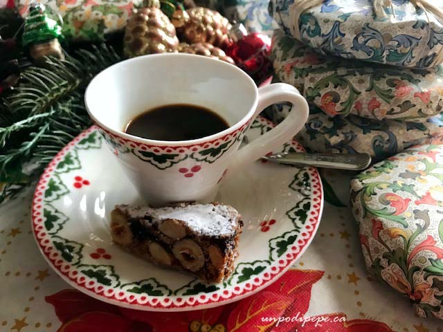 Panforte di Siena wedge with espresso and Christmas ornaments