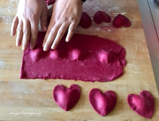 Heart shaped beet ravioli being shaped
